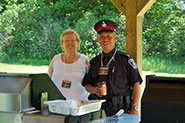 Organizers, Barb Taggart and Paul Chiang, help out with the BBQ.