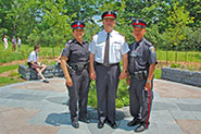 Chief of police, Armand La Barge and YRP Officers in the Peace Tree Garden at the Community Safety Village.