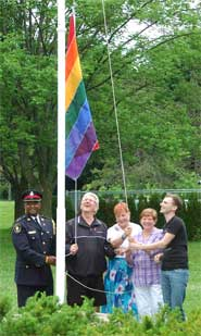 Insp. Ricky Veerappan, Dave Barrow, Marilyn Byers, Barbara Urman and Mike Taggart raise the Rainbow Flag at the Community Safety Village during our picnic and BBQ event.
