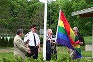 Chief Armand La Barge, Bill Fisch, Dave Barrow and Dave Williams raise the Rainbow Flag at the Community Safety Village during our picnic and BBQ event.