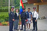 Guest speaker Chief Eric Jolliffe, York Regional Police officers and York Pride Fest volunteers prepare to raise the Rainbow Flag at the BBQ event.