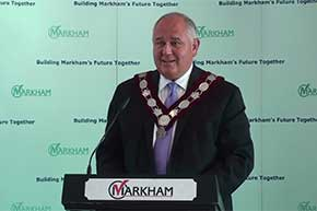Mayor Frank Scarpitti conveys greetings to attendees at the Town of Markham flag raising ceremony.