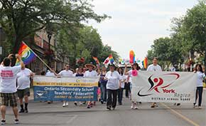 Ontario Secondary School Teachers' Federation and York Region District School Board representativves march in the parade.