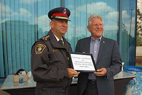 Mayor Dave Barrow and York Regional Police Chief Eric Jolliffe thank the Sheraton Parkway Hotel for refreshments provided at the Richmond Hill flag-raising ceremony.