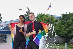 York Pride Fest volunteers celebrate the raising of the Rainbow flag in Markham.